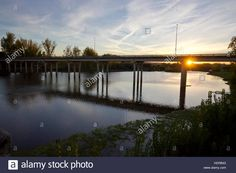 Download this stock image: Bridge crossing Alagon river at sunset (Coria, Extremadura). - HDRB43 from Alamy's library of millions of high resolution stock photos, illustrations and vectors.