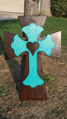 Brown and turquoise wall cross.
