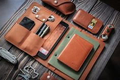 iPad and document organizer. iPad mini leather folio brown color. Cut and pierced by hands. Moreover, it's sewn by hands but not with a machine, what makes it even more precious. Your initials or other information can be added with stamping method. SIZES: W*H 390*235 mm (15.3*9.2 in) open
