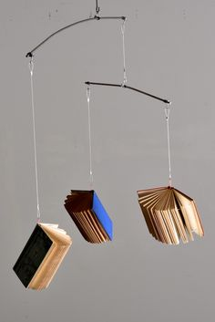 Book Mobile Art Project - the ultimate for book lovers... but can you bear to see your book skewered and hanging up there??