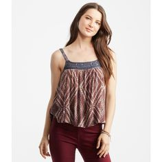 Aeropostale Tokyo Darling Diamond Swing Tank ($14) ❤ liked on Polyvore featuring tops, strappy top, print tank top, print tank, pattern tank top and white top