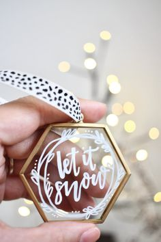 Make your tree sparkle with these unique glass hexagon ornaments. Each one is hand-lettered with beautiful calligraphy in permanent white ink. These ornaments are framed in brass. Choose your design from the following: Joy to the World $15 Let It Snow $15 Oh What Fun $15 Custom $20
