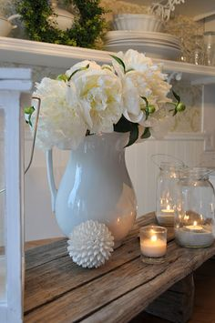 pretty white pitcher, peonies, candles in jars wallpaper in background, shelf and plates Fresh Flowers, White Flowers, Beautiful Flowers, Candle Jars, Candles, Mason Jars, Glass Jars, Clear Glass, Candle Holders