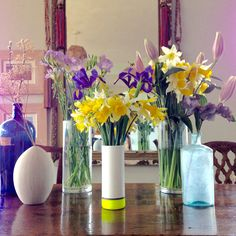 A @taz500 ceramic neon drainpipe vase sits against vintage glass bottles and a vase from @habitatuk Read the full article with the artist on #ecomodernstudios blog.