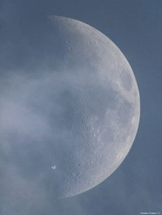 The International Space Station looks like the Starship Enterprise cruising past the moon in this photo