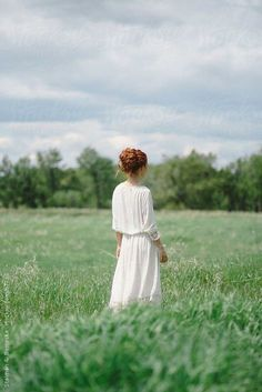 Stock photo of Beautiful young redhead woman standing in a field in a white dress by stalmanandboniecka Foto Nature, Poesia Visual, Lily Evans, Anne Of Green Gables, Woman Standing, Character Inspiration, Marie, Portrait Photography, Hair Colors