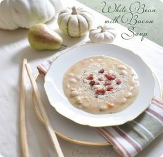 White Bean with Bacon Soup  1 lb dry cannellini beans (soaked as directed)  3 14.5 oz cans chicken or vegetable broth  3 medium shallots, finely diced  2 tbsp butter  2 bay leaves  ¾ tsp dried thyme  ¾ cup diced peeled carrots  5-6 strips cooked apple wood smoked bacon  ¾ cup lowfat milk  salt to taste