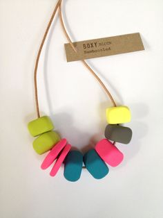 This is the BAMBOOZLED necklace. It is a handmade Boxy BLOCK necklace. It is made of seven handcrafted block beads with two flat ones - just for