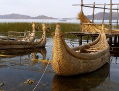 via www.mountainadventures.com  Lake Titicaca, Bolivia. These well known reed boats are finally being replaced by wooden boats. Most reed boats seen now are built for the tourists.