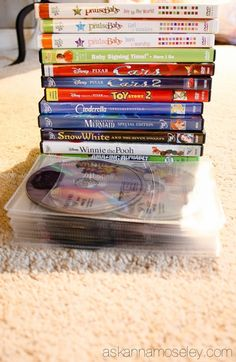 Have you ever thought about how to organize DVDs? We own 52 DVDs but you'd never know it by how little space they take up! Cd Storage, Storage Hacks, Storage Ideas, Movie Organization, Organizing Ideas, Golf Games For Kids, Organize Dvds, Baby Signing Time, Clean House