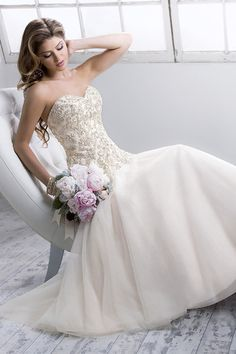 #Quincy Gown features embroidered and beaded lace I #SotteroandMidgley I http://www.weddingwire.com/wedding-photos/i/romantic-hollywood-glam-winter-fall-ivory-gold-classic-white-mermaid-dress-price-701-to-1500-dress-waist-dropped-dress-sleeveless-tulle-floor-strapless-sweetheart-sottero-midgley-beading-lace/i/9d9c49f9c50aa1ea-9c652ce2b0920d4e/af08a3344eb41ad1?tags=sottero-midgley&page=3&cat=dresses&type=search&tags=sottero-midgley I @Maggie Moore Sottero