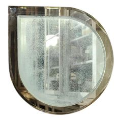 Love this Fontana Arte teardrop shaped mirror. Behind a sofa or above a console.  Voila!