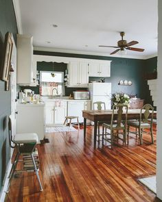 dark walls, white cabinets, incredible dining table