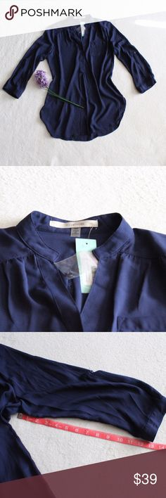 41Hawthorn Stitch Fix Colibri Solid Tab Sleeve Top BRAND NEW WITH TAGS. 41Hawthorn Colibri solid tab sleeve blouse. Navy blue. A bit sheer. Buttons down front and on sleeves. 100% Polyester  Please see photos for measurements.  Feel free to make an offer via offer button only. NO TRADES! 41Hawthorn Tops Blouses