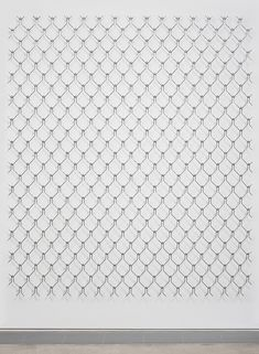 arthur analts\' borders installation is a series of mounted steel sculptures that initially resemble chain-link fences, but on closer inspection consist of interconnected shapes of people.