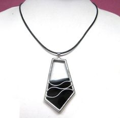 Stained glass pendant by lingglass, via Flickr