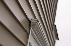 Find out what house siding types are available and the pros and cons of each so you can determine which siding option is best for your home. Exterior Remodel, Exterior Siding, Bungalow Exterior, Stucco Colors, Types Of Siding, Mid Century Exterior, Fiber Cement Siding, Siding Options, House Paint Color Combination
