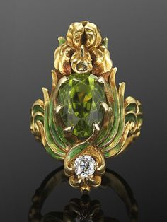 An Art Nouveau green enamel, peridot and diamond ring, by Marcus & Co., circa An yellow gold iris flower is painted with green enamel leaves centring an oval peridot of approximately carats, in a signed and dated ring mounting. Bijoux Art Nouveau, Art Nouveau Ring, Art Nouveau Jewelry, Jewelry Art, Antique Jewelry, Gold Jewelry, Vintage Jewelry, Fine Jewelry, Jewelry Design