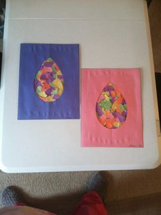 Torn construction paper was glued onto a sheet of construction paper. Then we glued another piece of construction paper with an egg shape cut out in the center on top.