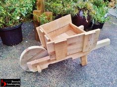 wheelbarrow planter/garden feature made of upcycled pallet wood - design and construction by Deresch Landscaping