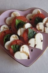 Instead of focusing on sweet treats this Valentine's Day, show your child how to make this tasty savory dish that's full of color, fresh flavors, and heart-healthy ingredients. Insalata Caprese, or salad in the style of Capri, is a simple dish from the Campania region of Italy. Here your child can add a Valentine's Day touch to this traditional salad by cutting the mozzarella into heart-shaped slices