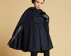 You will be warm in style this winter with this made-to-order warm wool cape from Xiaolizi. Show in dark blue, the extra large covered buttons add understated detail and the warm hood will guard you from the harsh winter wind. The mid-thigh length keeps this cape from being too dramatic or heavy. It will be the perfect addition to your winter wardrobe.   * More Choice avaiable *  Brown https://www.etsy.com/listing/251184863/wool-capehooded-capewarm-winter?ref=shop_review Black…
