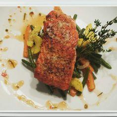 Pan seared salmon with saute veggies and herb chili sauce.