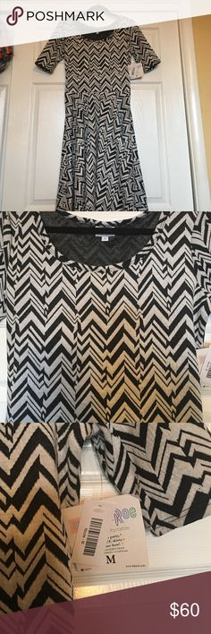 NWT LuLaRoe Nicole Black and White size M NWT perfect black and white Nicole size Medium add any other colors for a great splash!! LuLaRoe Dresses Mini