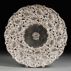 Large Reticulated Sterling Cake Plate early 20th century, with wide rim stamped and pierced with Rococo Revival diapered cartouches, C-scrolls and rose heads, monogrammed to center,