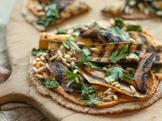 Vegetables soaked in a rich hummus marinade and then grilled make a superb topping for these tortilla pizzas