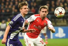 Anderlecht's midfielder Dennis Praet (L) runs for the ball with Arsenal's Spanish defender Nacho Monreal during a UEFA Champions League group stage football match Anderlecht vs Arsenal at the Constant Vanden Stock stadium in Anderlecht on October 22, 2014