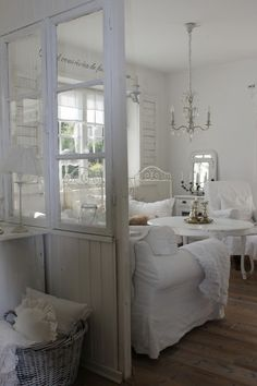 Shabby Chic - love the old doors as room divider.