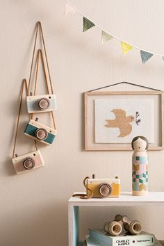 - Description - More Info. - The Brand This beautifully crafted wooden zoom toy camera featured a viewfinder, leather grip, carrying strap and zoom feature. Each camera is handsomely made by local art