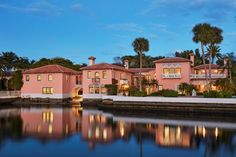"""""""Casa del Ensuenos"""", built in 1923, is a rare direct lakefront Mizner located in the Estate Section. The Venetian style estate offers a six bedroom Landmark house, a three bedroom guest house (not landmarked), a dock with boat lift, large pool with cabana and tropical gardens."""