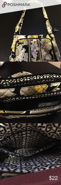 """Vera Bradlee shoulder bag Used but great condition Vera Bradlee shoulder bag. Approx. 9 1/2 x 6 1/2"""" with a strap drop of about 14"""". Front zipper pocket has card holder. Back pocket has magnet closure. One small zipper pocket on inside. Gold, army green & black in color. Great bag!! Vera Bradley Bags Shoulder Bags"""