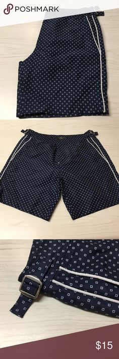 Lined Swim Short in Navy with Square Dots Brief Lined Swim Shorts with White Piping and Adjustable Waist Band. Retro styling and easily can be worn as shorts. 100% Polyester. Express Swim Swim Trunks