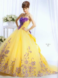 Gorgeous bright yellow dress with purple floral detail.