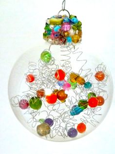 Very cool Christmas ornament -could definitely diy with orphan beads...