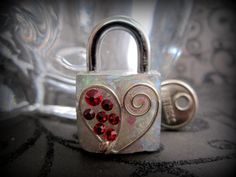 Etsy listing at https://www.etsy.com/listing/116899380/fetish-padlock-working-lock-mini-lock
