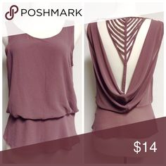 Mauve blouse Wore once. zipper detail on the side. Naked Zebra Tops Blouses