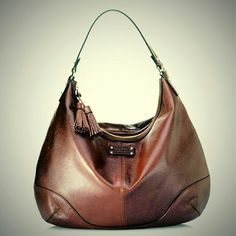 """Kate Spade Brooklyn Heights Brown Hobo Bag Brown Leather Brooklyn Heights Hobo Bag. For more than a century, Brooklyn Heights has lured elite city dwellers with sweeping views of Manhattan. In keeping with this tone, this slouchy hobo is comfortable to carry with pockets aplenty for tucking away your cell phone, notebook and favorite pot of lip-gloss. T onal trim and tassel detailing top things off with a final flourish. Measures approximately 12.5"""" X 15"""" X 4"""". Excellent preloved condition…"""
