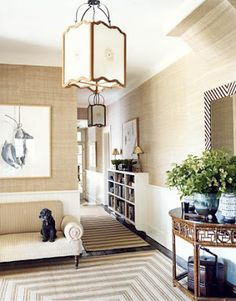 love how the grasscloth makes for a warm casual entry
