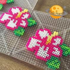 Hibiscus flowers perler beads by pixel_planet_