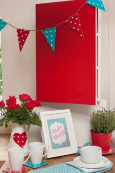 Cover a plain white kitchen cupboard door with glossy red self adhesive d-c-fix film for a 1950's retro look. The bunting has been made with d-c-fix polka dot in red and turquoise; http://www.amazon.co.uk/d-c-fix%C2%AE-Sticky-Plastic-adhesive-346-0627/dp/B00HLFMHNK/ref=sr_1_7?s=kitchen&ie=UTF8&qid=1398853639&sr=1-7&keywords=d-c+fix+polka+dot