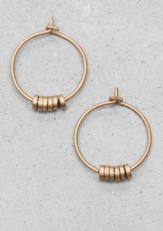 Love these delicate hoops.