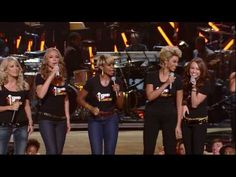 "Beyonce, Mariah Carey, Carrie Underwood, Miley Cyrus, Mary J. Blige and many more perform the hit song ""Just Stand Up."""