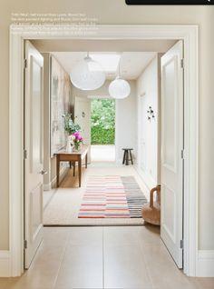 hallway. flooring + rug, muuto dots + pendants via EST