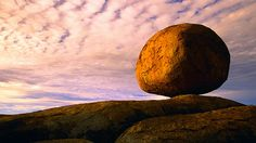 Immense egg-shape boulders called Karlu Karlu sit exposed in desert air at the Devils Marbles Conservation Reserve in the Northern Territory of Australia. Visit Australia, Australia Travel, Marbles Images, Red Centre, Top Travel Destinations, Wow Products, Bouldering, Geology, Hd Wallpaper