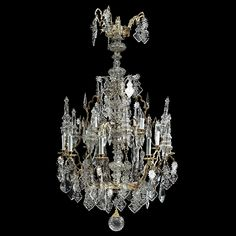 French Gothic Revival Gilt Bronze Iron & Glass 12-Light Chandelier. Mid 19th century. Condition restored