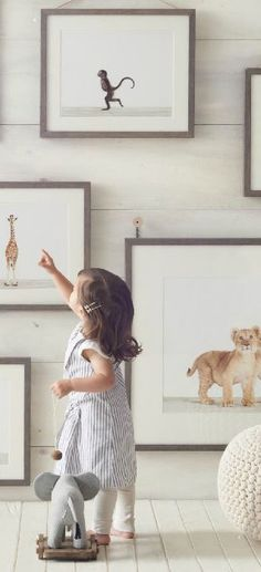 I love that the frames are so low that the baby can see and interact with them xx grey ribba frames | Ikea Innocent Beginnings Artwork